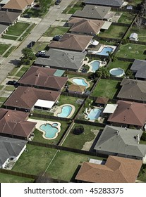 Aerial of typical U.S. middle-class suburb with backyard pools