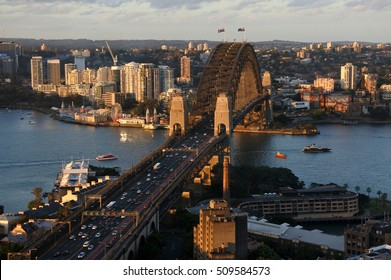 Aerial urban landscape view of Sydney Harbor at sunset with North Sydney and The Rocks in Sydney New South Wales, Australia.