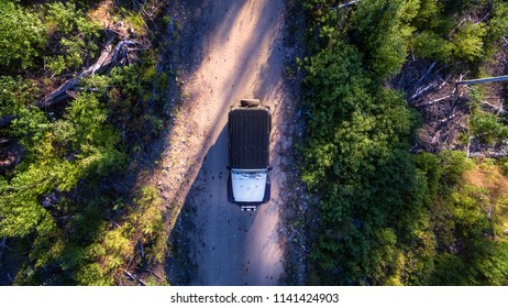 Aerial Of Vehicle On Wilderness Dirt Road