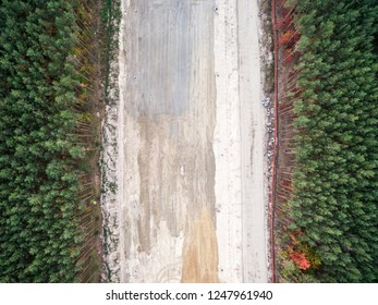 aerial veiw of empty building place of new road in green forest. Drone shot