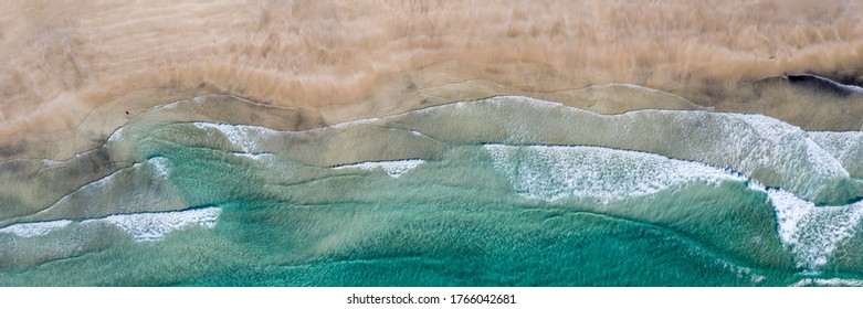 Aerial vertical View Splashing Sea Waves on the Beach