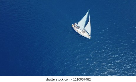Aerial viev. yacht with white sails in the blue sea
