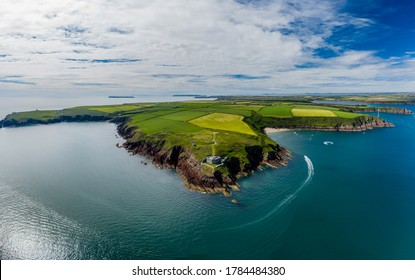 Aerial view of 19th century coastal fort on clifftops surrounded by fields and ocean (Milford Haven, Wales)