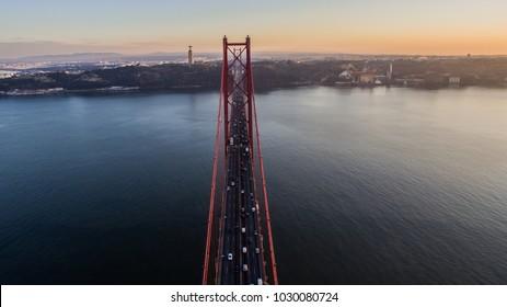 Aerial view 25 april bridge in Lisbon, Portugal. Ponte 25 de abril. Sunset.