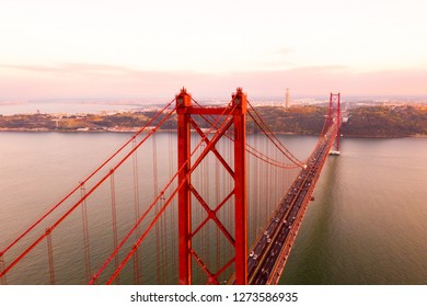 Aerial view of the 25 April bridge is a steel suspension bridge located in Lisbon, Portugal, crossing the Targus river. It is one of the most famous landmarks of the region.