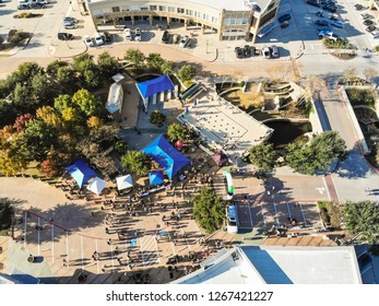 Aerial view 5K Turkey Trot family running event in Cedar Hills, Texas, USA. Straight down look of finish line with runners