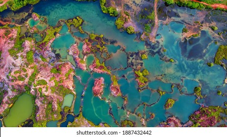 Aerial view of an abandon quarry with beautiful shape. Soft focus effect due to large aperture setting