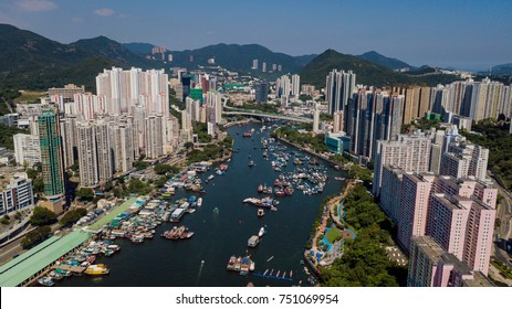 Aerial View of the Aberdeen Harbour (Aberdeen Typhoon Shelter) with boats & vessels and many residential buildings on the 2 sides of the harbour.