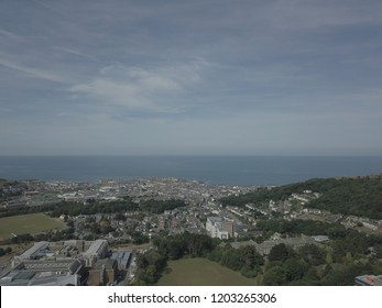 Aerial view of Aberystwyth taken from above the Arts Centre looking out to sea.
