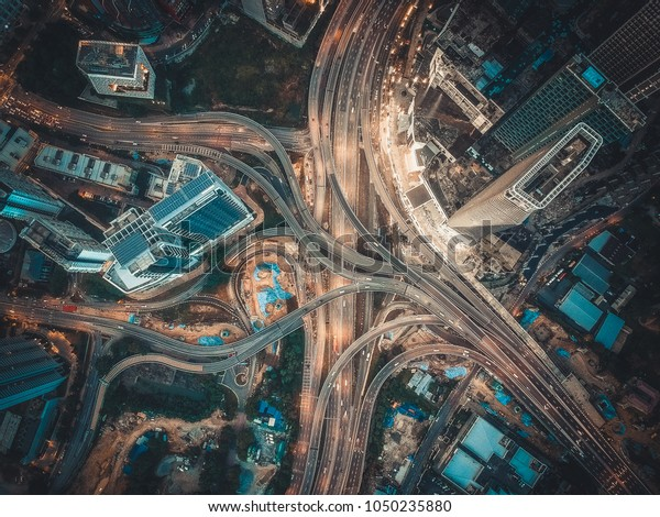 Aerial View Above of Busy Highway Intersection Road Junctions at morning. The image contain soft focus, grain and noise.