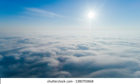 Aerial view above the clouds. Flying on a copter over a thick fog.