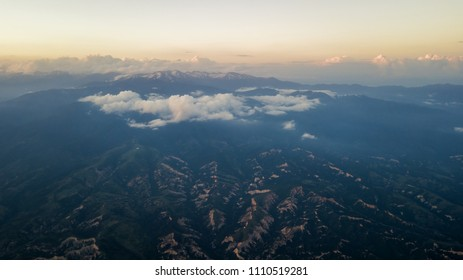 Aerial view above clouds in morning mountains.