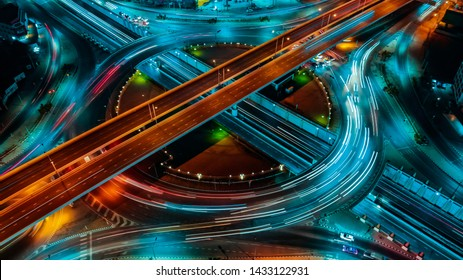 Aerial View Above of elevated road junction and traffic an important transport at night