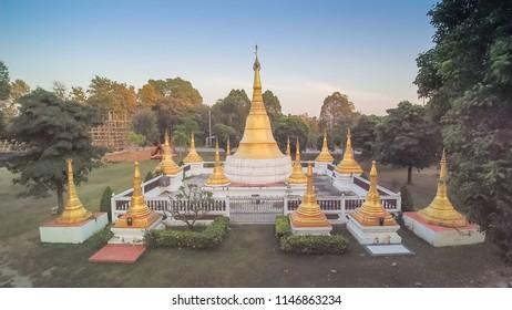 Aerial view above the golden pagoda (Mon style) around with green forest, Wat Makham, Nakhon Chum known as little Sangklaburi, Banpong, Ratchaburi, Thailand