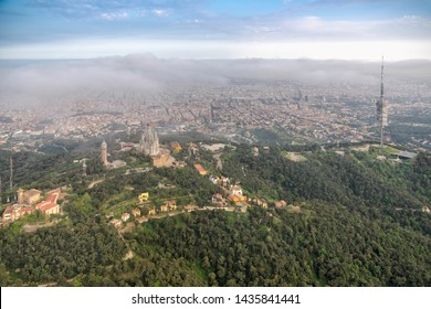 Aerial view above mountains with park overlooking city of Barcelona, Spain