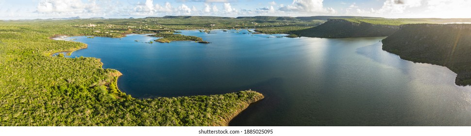 Aerial view above scenery of Curacao, Caribbean with ocean, coast, hills