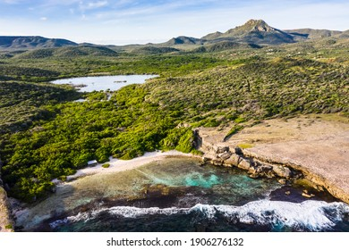 Aerial view above scenery of Curacao, Caribbean with ocean, coast, hills, lake