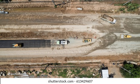 aerial view aboveroad construction worker view from drone .