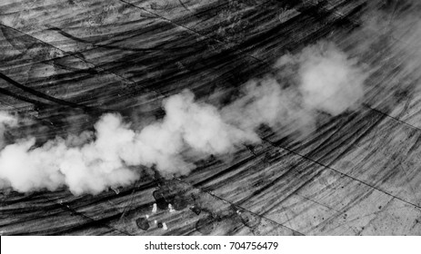Aerial view abstract texture and background black car tire marks on road race track and white smoke on race track.