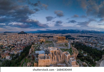 Aerial view of Acropolis of Athens, the Temple of Athena Nike, Parthenon, Hekatompedon Temple, Sanctuary of Zeus Polieus, Odeon of Herodes Atticus, Erechtheion at sunset