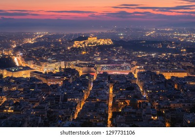 Aerial view of the Acropolis and city of Athens seen at dawn from Lycabettus hill after the sunset, Greece