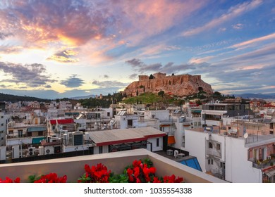Aerial view of the Acropolis Hill, crowned with Parthenon at gorgeous sunset in Athens, Greece
