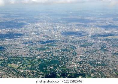 Aerial view across South East London with Crystal Palace at the bottom of the image and the skyscrapers of Canary Wharf in the middle surrounded by the sweep of the River Thames
