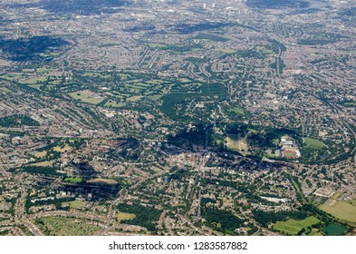 Aerial view across South London with the television transmitters and National Sports Centre of Crystal Palace at the bottom and the warehouses of Rotherhithe beside the River Thames towards the top.