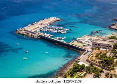 Aerial view of the Addaura harbour and beach with turquoise sea and boats near Mondello, Palermo, Sicily.