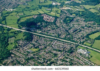 Aerial view of Addlestone in Surrey with the M25 motorway cutting the residential areas in two with Row Town to the upper part of the picture.  In the bottom left corner is Jubilee High School.