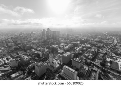 Aerial view of afternoon clouds over downtown Los Angeles in black and white.