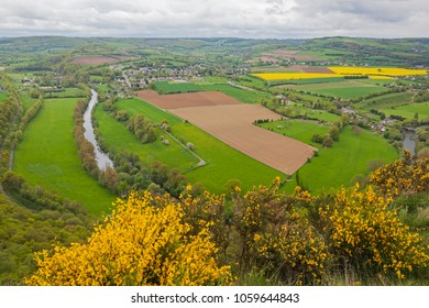 Aerial view of agricultural area of Normandy with arable land, flowering rapeseed and green fields in spring day, France