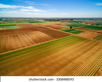 Aerial view of agricultural fields - plowed and with crops on summer day in Australia