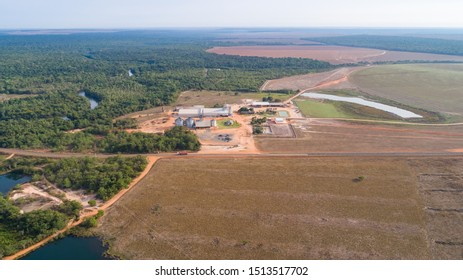Aerial view of agricultural landscape with a big farm, border to remaining rainforest, signs of deforestation, San Jose do Rio Claro, Mato Grosso, Brazil