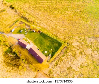 Aerial view to agricultural lanscape with farm house. Sustainable development and ecology.