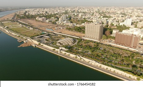 Aerial view of Ahmedabad,Gujarat,India. Riverfront and garden with skyline buildings drone view landscape. Post coronavirus covid-19 city reopens. social distancing rules after city restrictions ease.