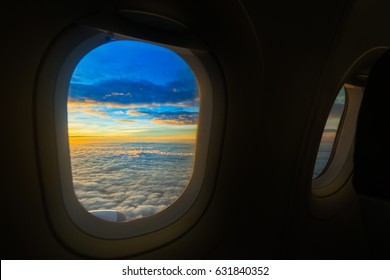 Aerial view from airplane window  with the sky  sunset and cloud,