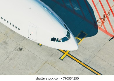 Aerial view of the airport. Airplane is preparation before take off.