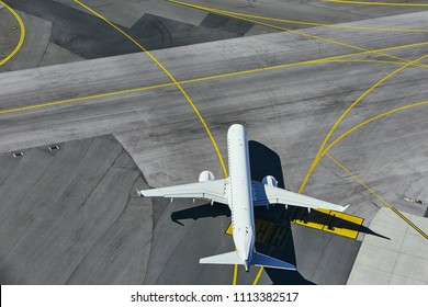 Aerial view of the airport. Airplane taxiing to runway.