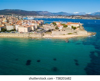 Aerial view of Ajaccio, Corsica, France. The harbor area and city center seen from the sea. Harbor boats and houses