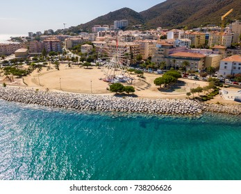 Aerial view of Ajaccio, Corsica, France. Ferris wheel and playground in the city center seen from the sea