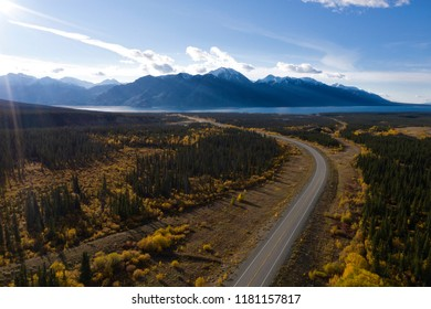 Aerial view of the Alaska Highway leading towards Kluane Lake in the Yukon in Canada on a sunny day during the Indian Summer.