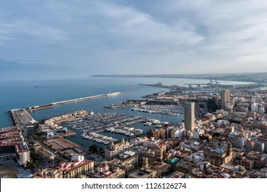 Aerial view of Alicante city from Santa Barbara Castle, showing the marina.