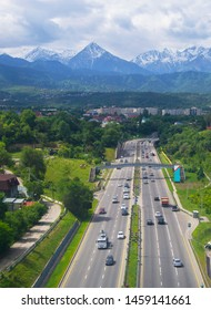 Aerial view of Almaty (Kazakhstan). Highway, city, mountains. Summer day