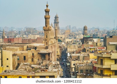 Aerial view of Al-Muizz street of Islamic Cairo with mosques, palaces and residential buildings from the minaret of Sultan Al-Ghuri Mosque-Madrasa, Cairo, Egypt.