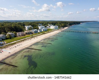 Aerial view along the coast and the beautiful historic white houses in Heiligendamm in Bad Doberan at the baltic sea, Germany - the houses are partly renovated, partly still run down
