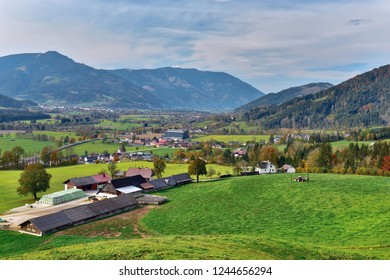 Aerial view of the alpine village surrounded by the Alps mountains on a sunny autumn day. Weng im Gesaeuse, state of Styria, Austria, Europe.