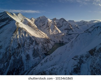 Aerial view of the Alps. Peaks of mountains in the snow in winter. Austria. Natural backround