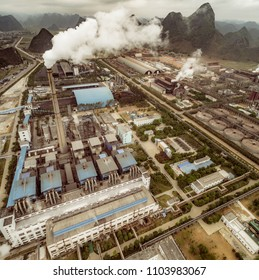 aerial view of alumina factory and mountains