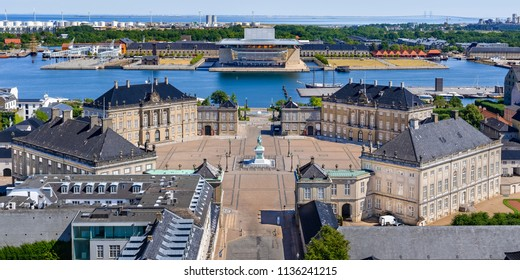 Aerial view of Amalienborg Palace in Copenhagen, Denmark. Surrounding the palace square with its statue of King Frederik V from 1771, Amalienborg is made up of four identical buildings.